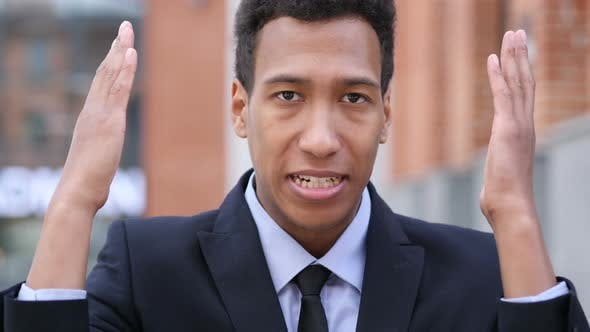Thumbnail for Angry Yelling African Businessman Reacting to Problem at Work