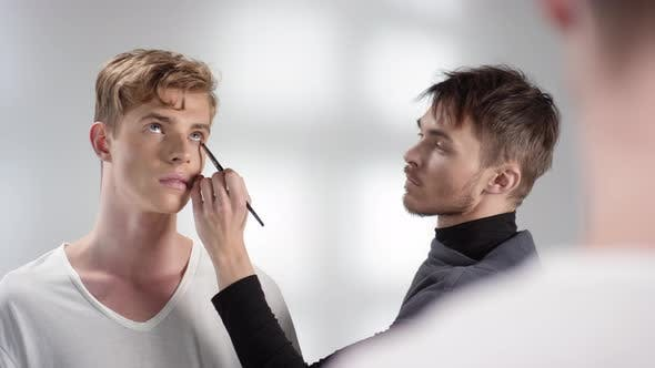 Thumbnail for Beautician Using Eyeshadow for Male Makeup