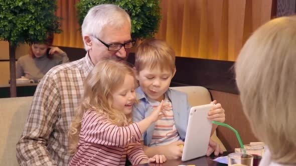Thumbnail for Kids and Grandfather Taking Selfie with Tablet