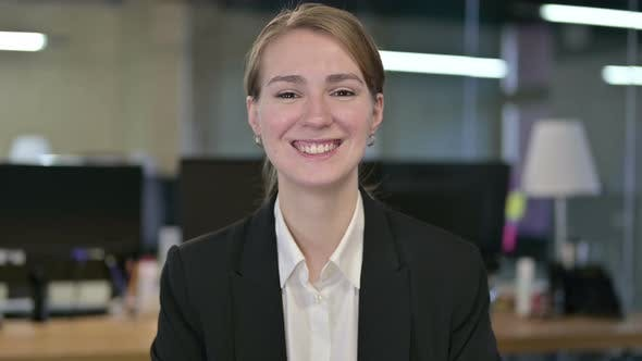 Thumbnail for Portrait of Smiling Young Businesswoman Looking at the Camera