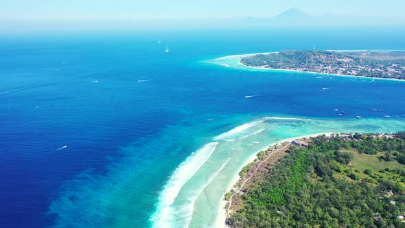 Thumbnail for Wide angle flying tourism shot of a white sand paradise beach and blue sea background in hi res 4K