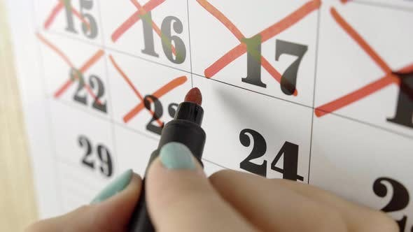Thumbnail for Female Hand Crosses with Red Marker the Calendar Day 24. Slow Motion Shot. Close Up