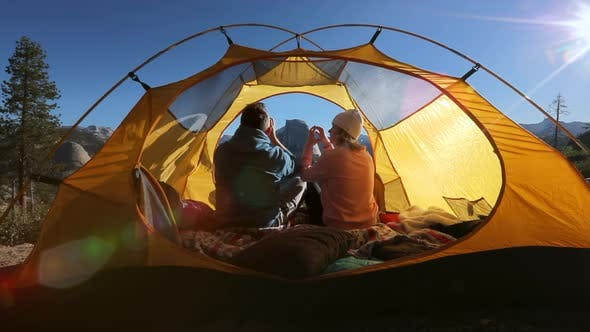 Thumbnail for Embrace of Two Lovers in a Tent Pierced By Dawn Rays in Yosemite Valley. California, USA