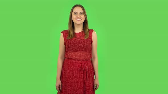 Thumbnail for Tender Girl in Red Dress Is Smiling While Looking at Camera and Crossing Her Arms on Chest. Green
