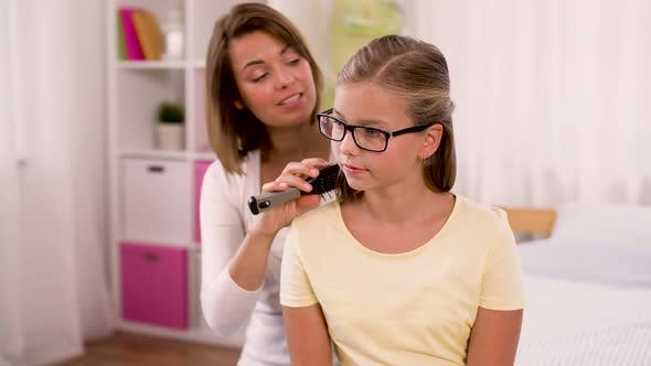 Thumbnail for Happy Mother Brushing Daughter Hair at Home 31