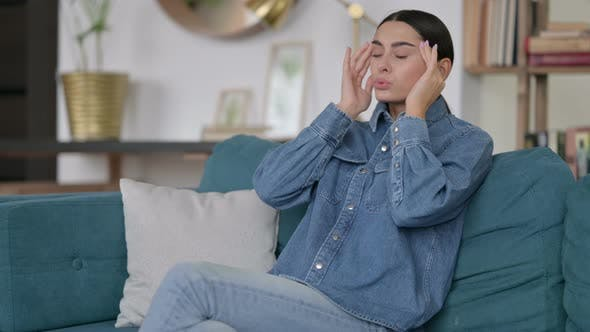 Thumbnail for Latin Woman with Headache on Sofa