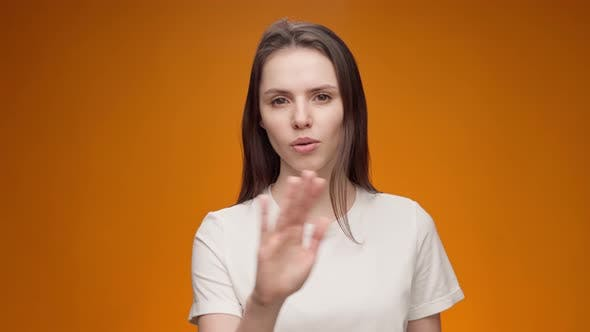 Young Woman Expressing Aversion Rejection Negative Attitude Against Yellow Background