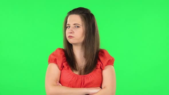 Thumbnail for Portrait of Cute Girl Is Offended and Then Smiling. Green Screen