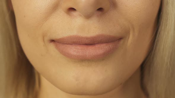 Thumbnail for Close-up Shot of Teeth and Lips of Beautiful Girl