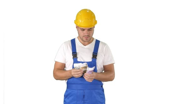 Thumbnail for Builder Counting Money Standing on White Background