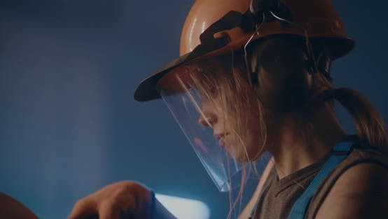 Professional Female Metalworker in Manufacture