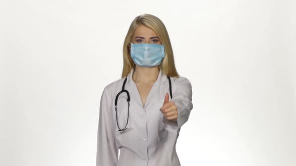 Thumbnail for Female Doctor Making Thumbs Up Sign. White