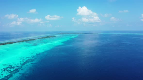 Thumbnail for Wide overhead abstract shot of a white paradise beach and aqua blue water background in colorful