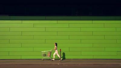 Shopper Runs with Purchases Near Shop