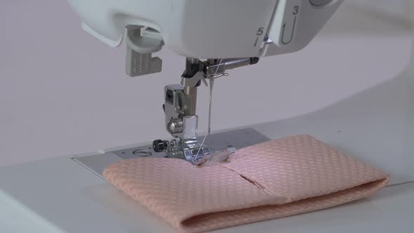 Thumbnail for Hands preparing a fabric for sewing