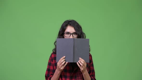 Thumbnail for Young Beautiful Businesswoman Covering Face with Book
