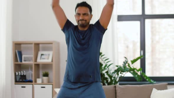 Cover Image for Indian Man Doing Jumping Jack Exercise at Home