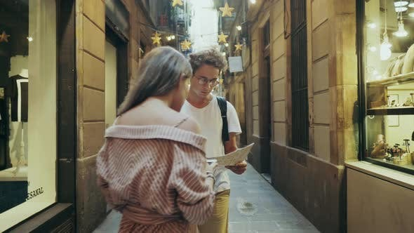 Thumbnail for Focused Student Searching Way with Map. Pretty Woman Showing Right Way To Man