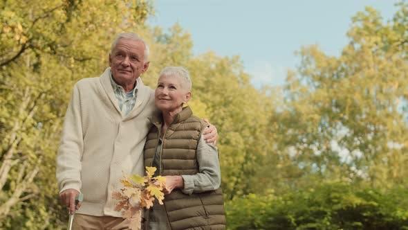 Thumbnail for Senior Family Couple Hugging in Park