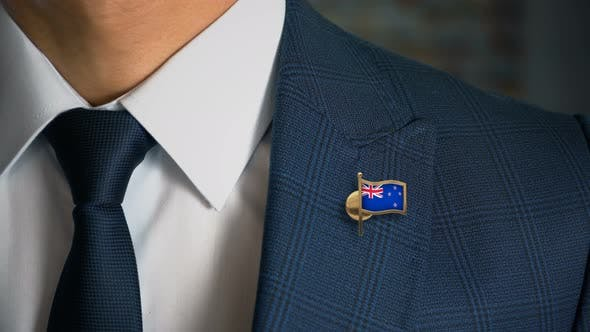 Thumbnail for Businessman Walking Towards Camera With Country Flag Pin New Zealand