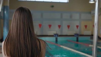 Woman in a Public Pool