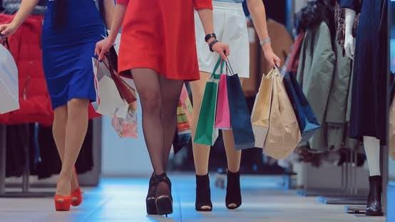Shopaholic Female Legs with Shopping Bags