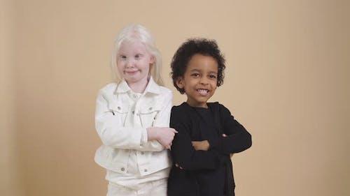 Tender, Sensitive Albino Girl Touch Face of Mulatto Boy