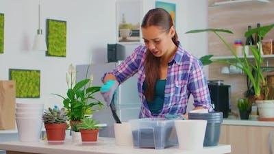 Putting Soil in Flowerpot
