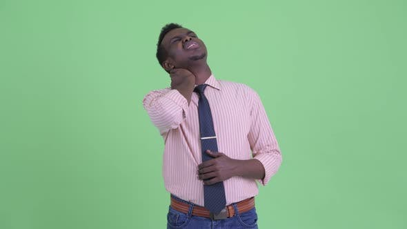 Thumbnail for Stressed Young African Businessman Having Neck Pain