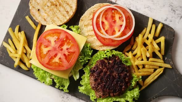 Thumbnail for Two Tasty Grilled Home Made Burgers with Beef, Tomato, Onion and Lettuce
