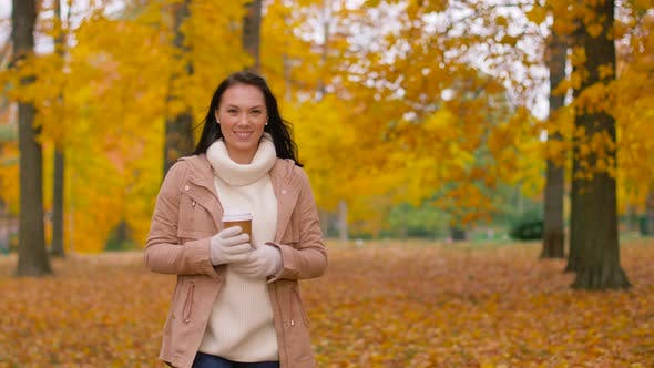Thumbnail for Woman Drinking Takeaway Coffee in Autumn Park 8