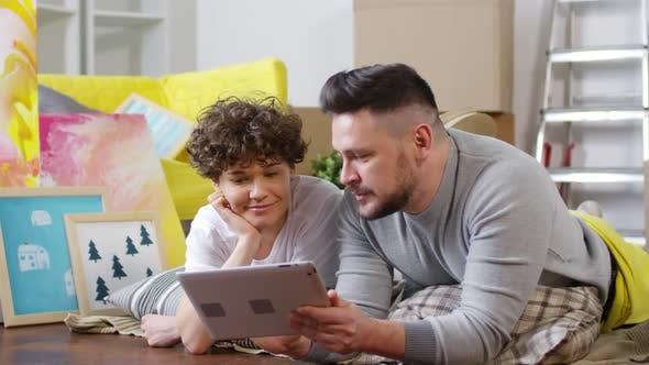 Thumbnail for Middle-Aged Caucasian Couple Shopping Online on Tablet in New Flat