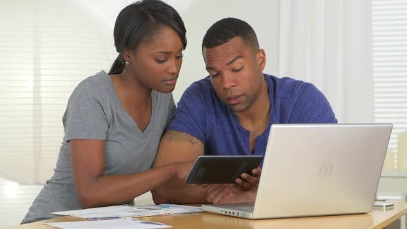 Thumbnail for Black couple using tablet to review accounts