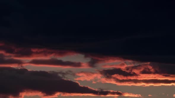 Thumbnail for Timelapse of Dark Clouds in Evening Sky