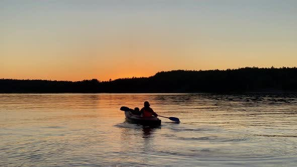 Thumbnail for Silhouette of Person Rowing Kayak Along Tranquil Lake