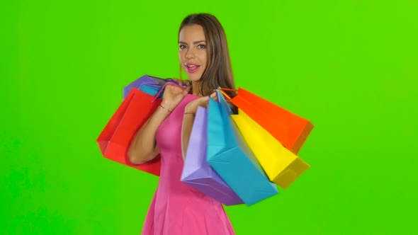 Thumbnail for Woman Smiling While Holding Shopping Bags. Green Screen