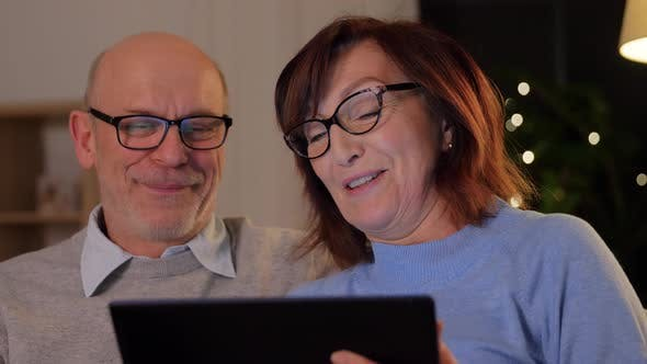Thumbnail for Happy Senior Couple with Tablet Pc at Home
