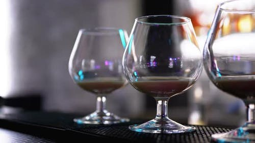 Glasses with a Cocktail at the Bar Counter