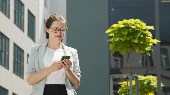 Thumbnail for Business Woman Working with Mobile Smartphone in the City Center Among Modern Houses, Modern Woman