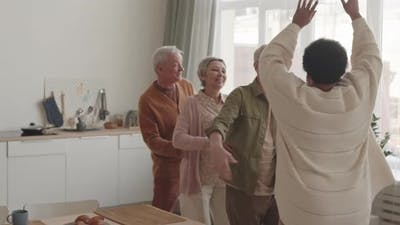 Happy People Dancing Conga at Home