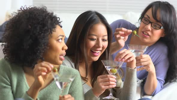 Thumbnail for Three women hanging out in living room drinking martinis