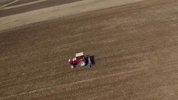 Thumbnail for Combine Plowing Agricultural Field in the Spring