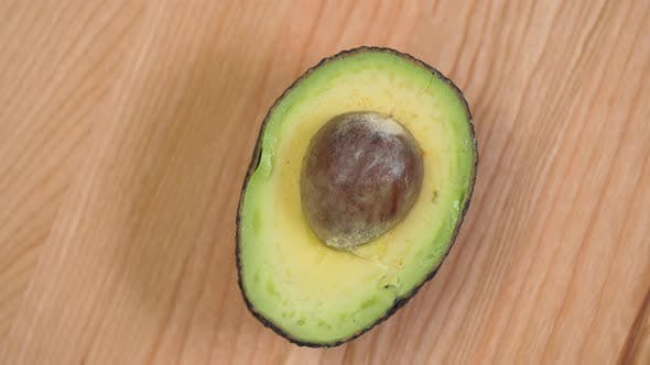 Thumbnail for Half An Avocado With Nut Spinnin On Cutting Board 03