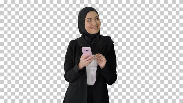 Smiling arab woman using smart phone, Alpha Channel