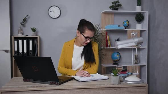 Thumbnail for Concentrated Businesswoman in Stylish Jacket Working on Computer at Home