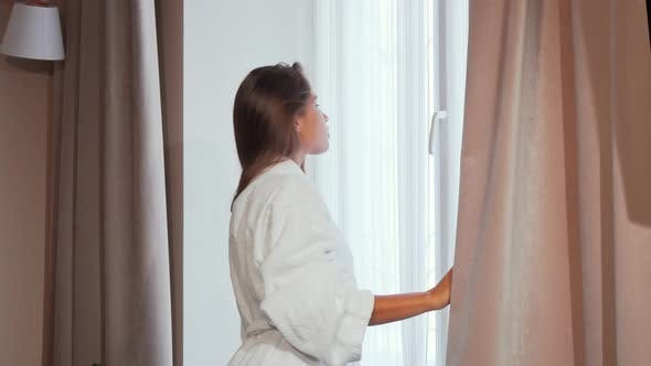 Thumbnail for Gorgeous Young Woman Looking in the Window in the Morning