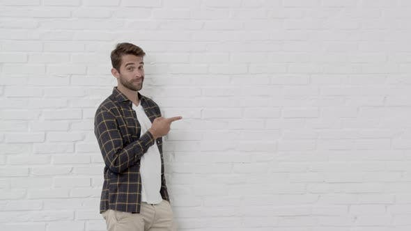 Thumbnail for Smiling Guy Pointing To Brick Wall