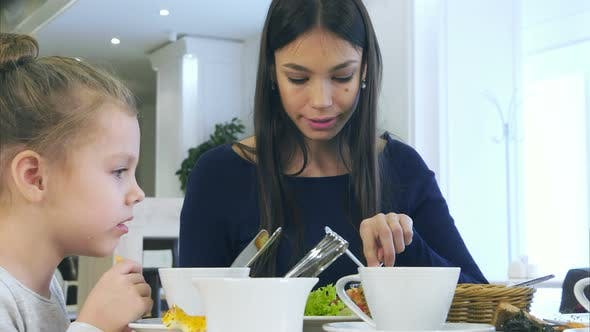 Thumbnail for European Harmonious Family Have Healthy Lunch in Cafe