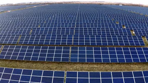 Renewable ecological source of energy from the sun. Aerial view of Solar Panels Farm.