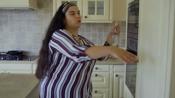 Thumbnail for Fat Girl Opens the Refrigerator